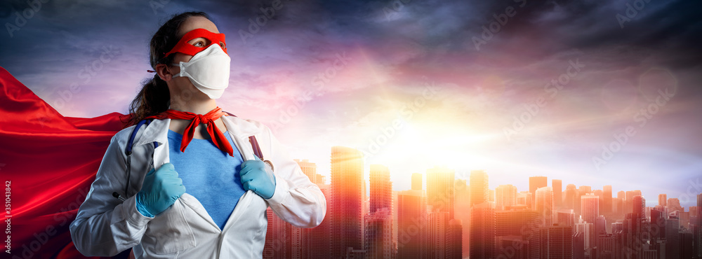 Fototapeta Doctor In Face Mask And Superhero Cape At Sunset