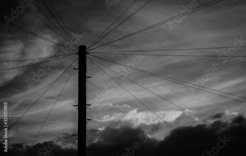 Fototapeta Low Angle View Silhouette Electricity Pylon Against Cloudy Sky At Dusk