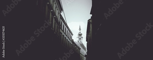 Canvas Print Panoramic Shot Of Clock Tower Against Sky Seen From Alley