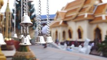 Close-up Of Bells Hanging Outside Temple