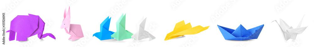 Fototapeta Many origami figures on white background