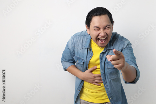 Man laughing Hard Bully Expression and Pointing Forward Wallpaper Mural