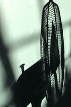 Shadow Of Table Fan On Wall At Home