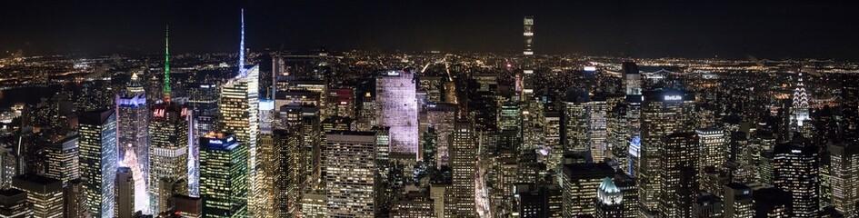 Illuminated Cityscape Against Sky At Night