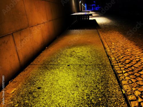 Carta da parati Illuminated Walkway By Paving Stone Street At Night