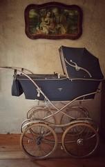 Fototapeta na wymiar Baby Carriage On Floorboard At Home