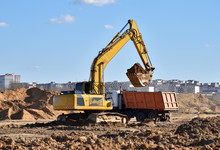 Excavator Load The Sand To The...
