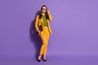 Leinwanddruck Bild - Full size photo of smart cool executive business lady leader expert touch hands spectacles hold laptop wear trousers blazer stilettos isolated violet color background