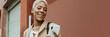 Leinwandbild Motiv Happy black businesswoman using her smartphone