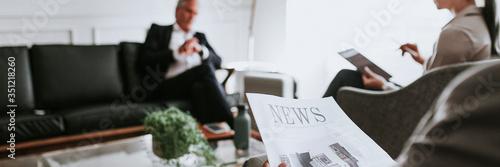 Fotografia, Obraz Busy businessman reading a newspaper in the lounge