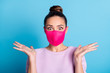 Portrait photo of pretty lady keep social distance people contacting responsible citizen crazy expression raise arms good news wear protect face mask sweater isolated blue color background