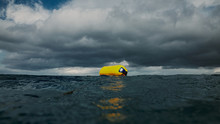Diving Buoy And Clouds
