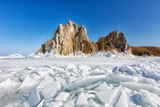 Rocks covered with ice on Lake Baikal in sunny winter day