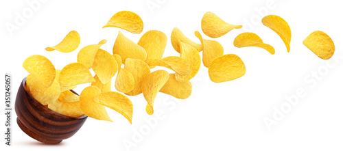 Valokuvatapetti Potato chips falling into wooden bowl isolated on white background