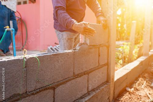 Masoners constructing masonry to build fences Wallpaper Mural