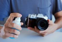 Man Disinfecting His Camera