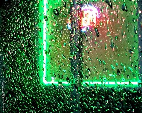 Canvas Illuminated Lights Seen Through Wet Car Windshield During Monsoon