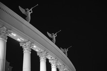 Low Angle View Of Caesars Palace Against Sky At Night