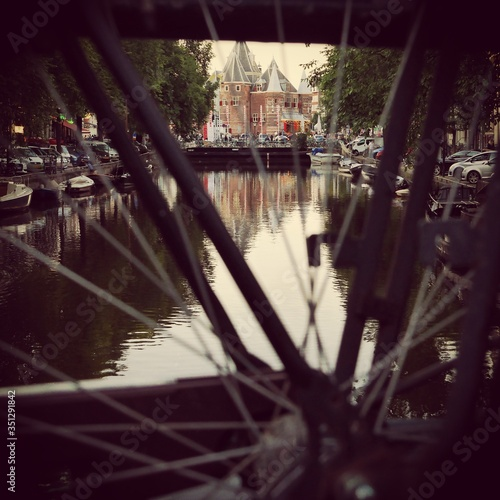 Photo View Of Canal Through Bicycle Wheel
