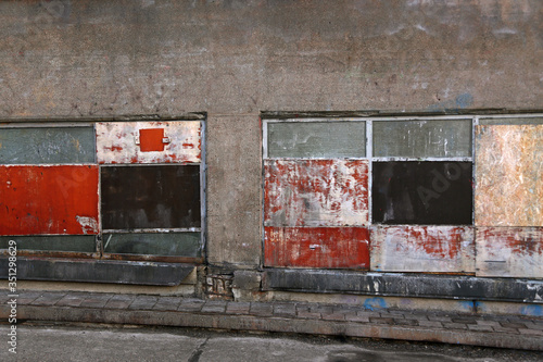Gray cement dirty wall with filled windows Canvas Print