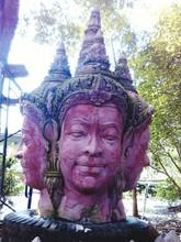 Religious Statues Against Tree