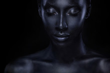 Woman With Black Body Paint. C...