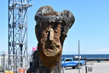 Wooden Head Statue On Harbour