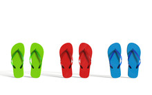 Colorful Flip Flops On A White...
