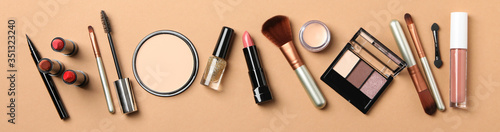 Fototapeta Different makeup cosmetics on brown background. Female accessories obraz