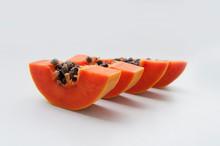 Close-up Of Papaya Slices On White Background
