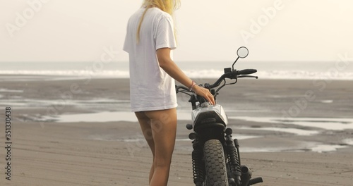 Young woman biker with custom cafe racer Wallpaper Mural