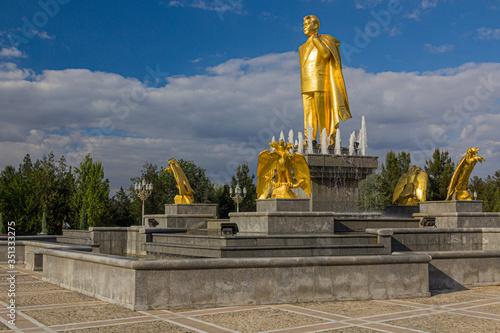 ASHGABAT, TURKMENISTAN - APRIL 17, 2018: Saparmurat Niyazov golden statue in Ash Canvas Print