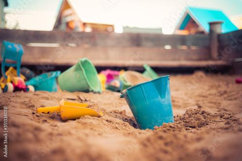 Fotografie, Obraz Childhood sandbox concept: Close up of plastic toy bucket