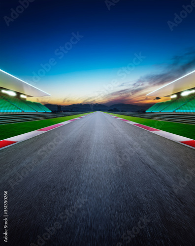 Fotografie, Obraz Diminishing Perspective Of Empty Motor Racing Track Against Sky During Sunset