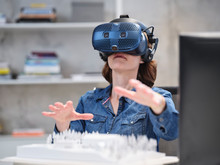 Woman Wearing VR Glasses And H...