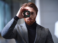 Portrait Of Businessman Lookin...