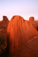 USA, Sandstone Rock Formation In Monument Valley With West Mitten Butte And Merrick Butte In Background