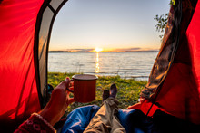 Man Camping In Estonia, Watchi...