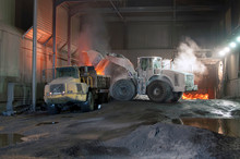 Germany, Steel Mill, Removal Of Slag With Shovel Excavator