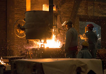 Germany, Two Men At Work In Foundry