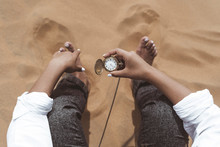 Woman's Hand Holding Old Pocket Watch, Merzouga Desert, Morocco