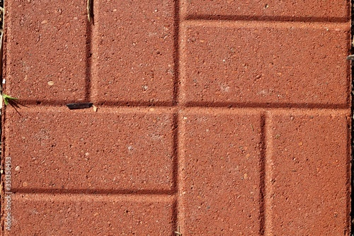 A close view of the red brick surface.