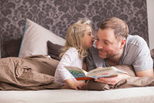 Father And Daughter Reading A ...