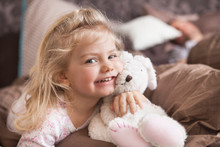 Portrait Of Girl With Her Cuddly Toy