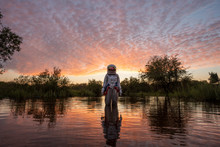 Spacewoman Standing In Water A...