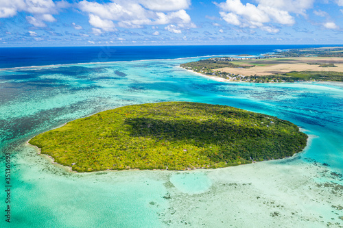 Lush vegetation on Ile aux Aigrettes atoll in the turquoise lagoon, aerial view by drone, Pointe d'Esny, Mahebourg, Mauritius, Indian Ocean, Africa - 351361693