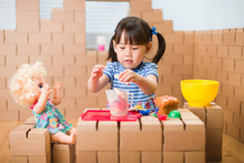 Toddler Girl Pretend Play Baby Care In A Cardboard Block House