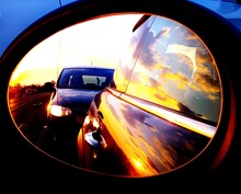 Reflection Of Cars On Side-view Mirror During Sunset