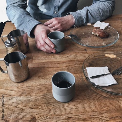 Fotografiet High Angle View Of Man Drinking Coffee