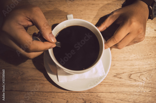 Cropped Hands Of Person Holding Coffee Cup On Table Tapéta, Fotótapéta